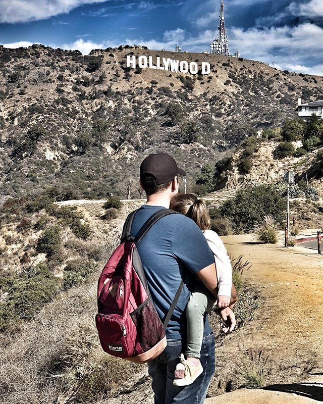Man and child in front of Hollywood Sign