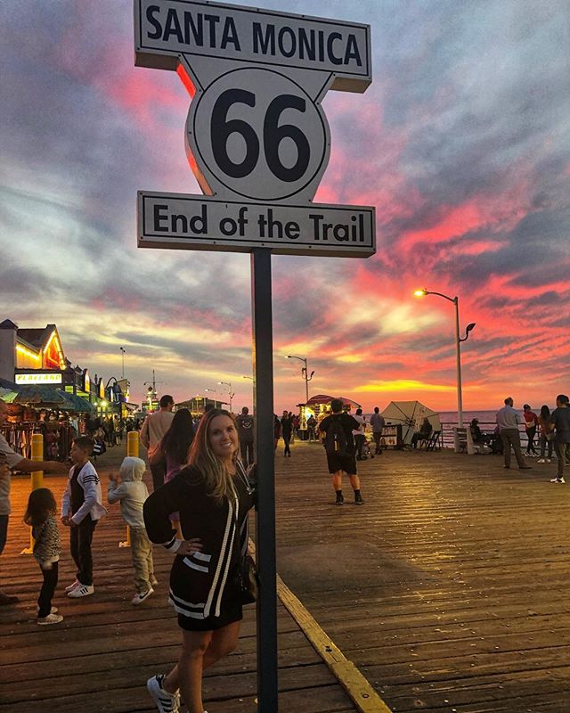 Woman posing with Route 66 sign at Santa Monica Pier in California. | 1 Week in Los Angeles, California
