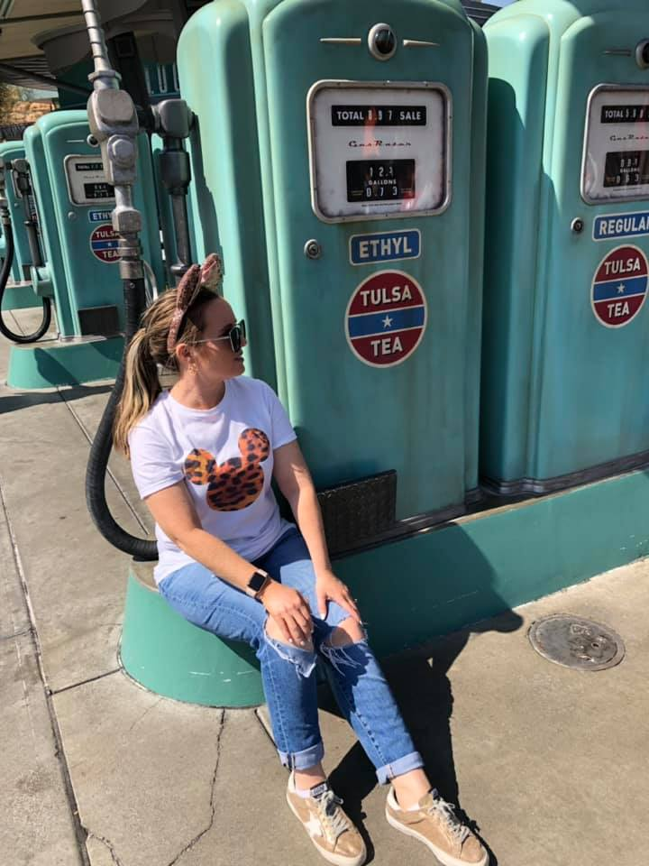 Woman posing with gas pumps.| What to Wear to Disneyland