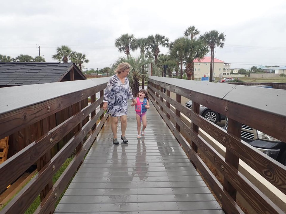 Woman walking with little girl on the boardwalk in Destin. | Destin, Florida with the Kids