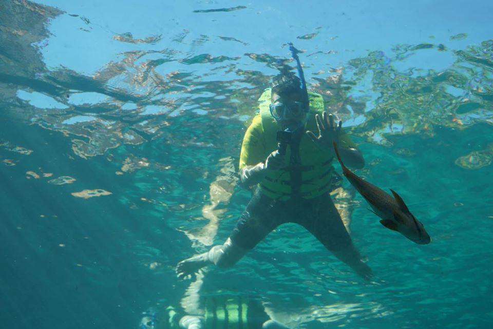 Man snorkeling in the water at the Atlantis resort. | Atlantis, Bahamas