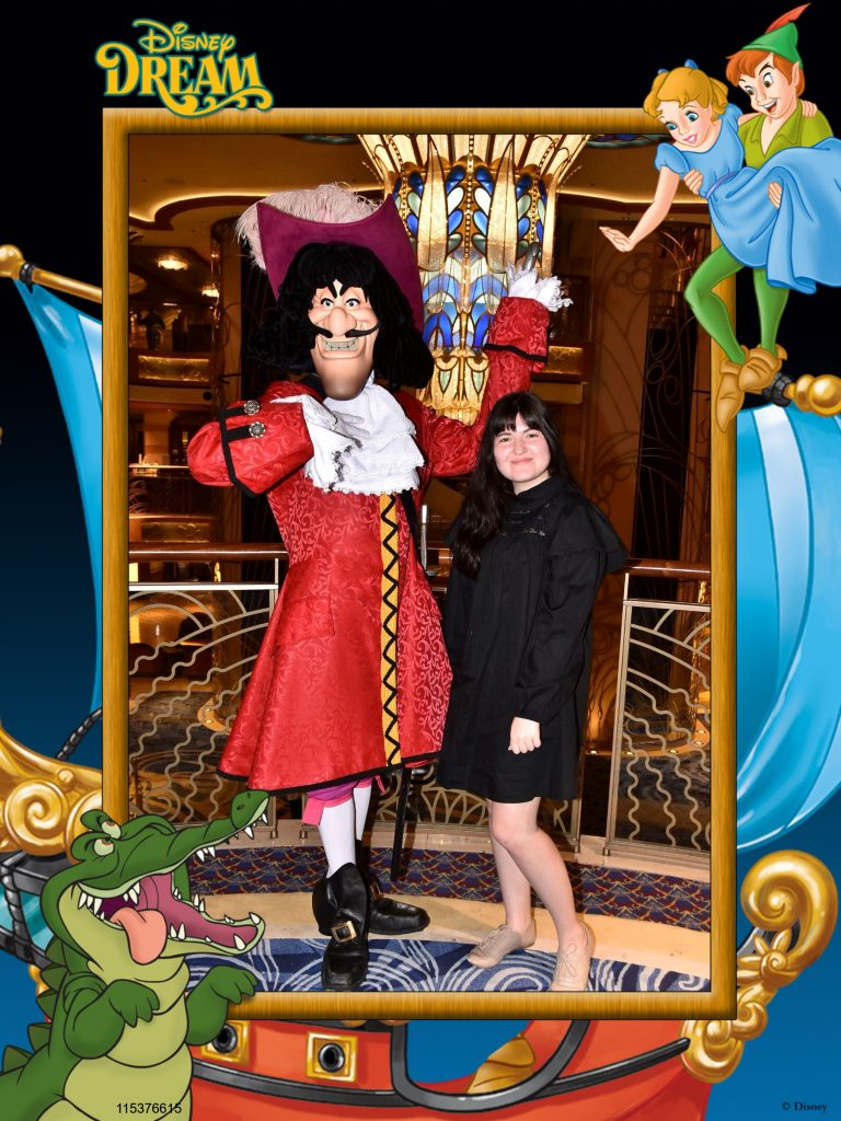 Girl posing with captain hook character.| Disney Dream Cruise