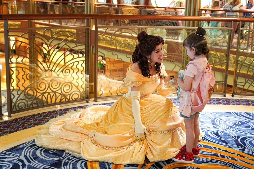 Little girl talking with the character Belle on the cruise ship.| Disney Dream Cruise