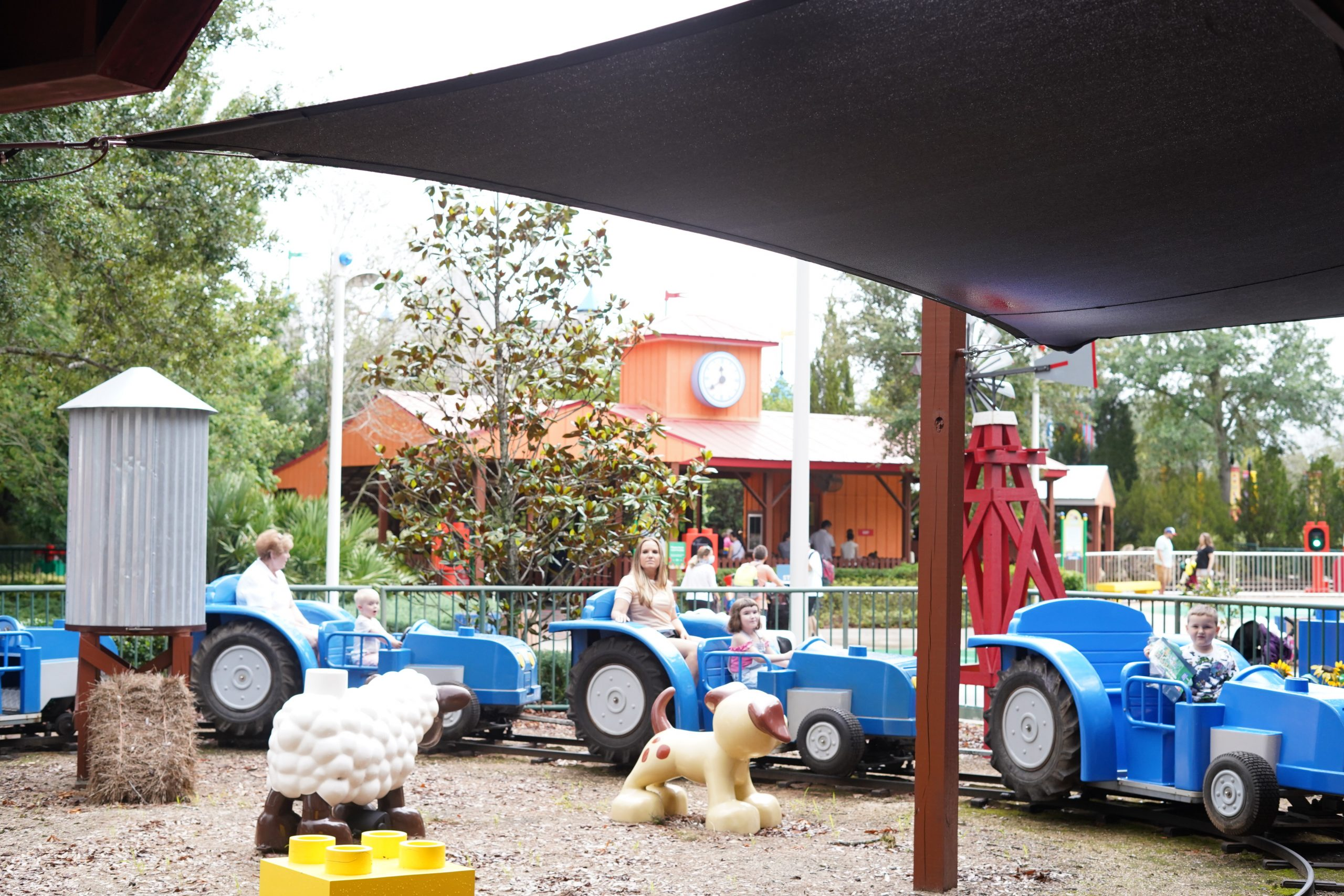 People riding a ride in DUPLO valley in LEGOLAND.  | Guide to LEGOLAND Florida