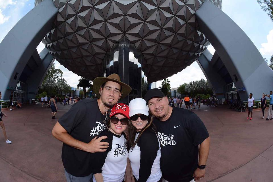 People posing in front of Epcot at Disney World.   Disney World- What you need to know.