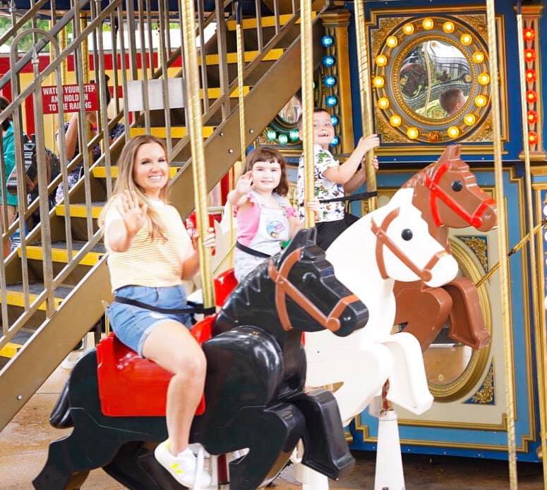 Mom with two kids on merry-go-round at Fun Town in LEGOLAND.  | Guide to LEGOLAND Florida
