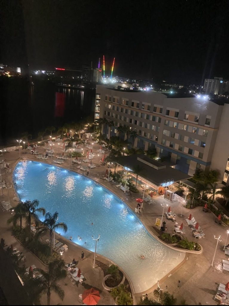 Aerial view of the pool at night at Universal Endless Summer Resort in Universal Studios.   A Guide to Universal Studios Orlando with Kids