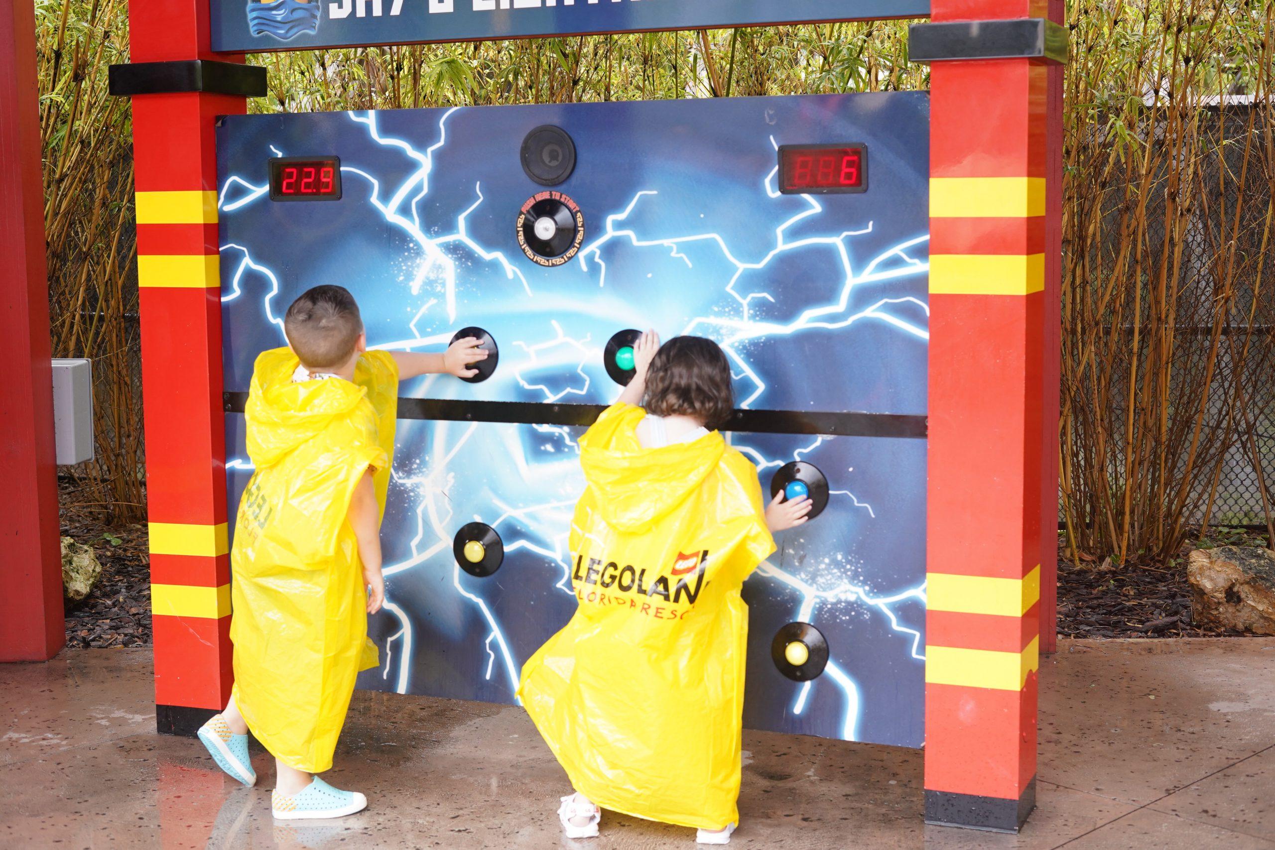 Two kids playing Jay's Lighting Drill at Ninjago world at LEGOLAND. | Guide to LEGOLAND Florida