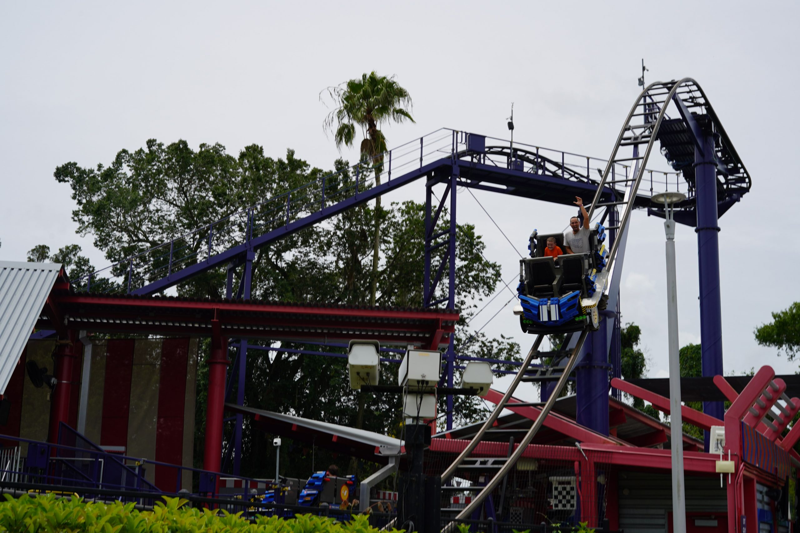 People riding a rollercoaster called Technic at LEGOLAND. | Guide to LEGOLAND Florida