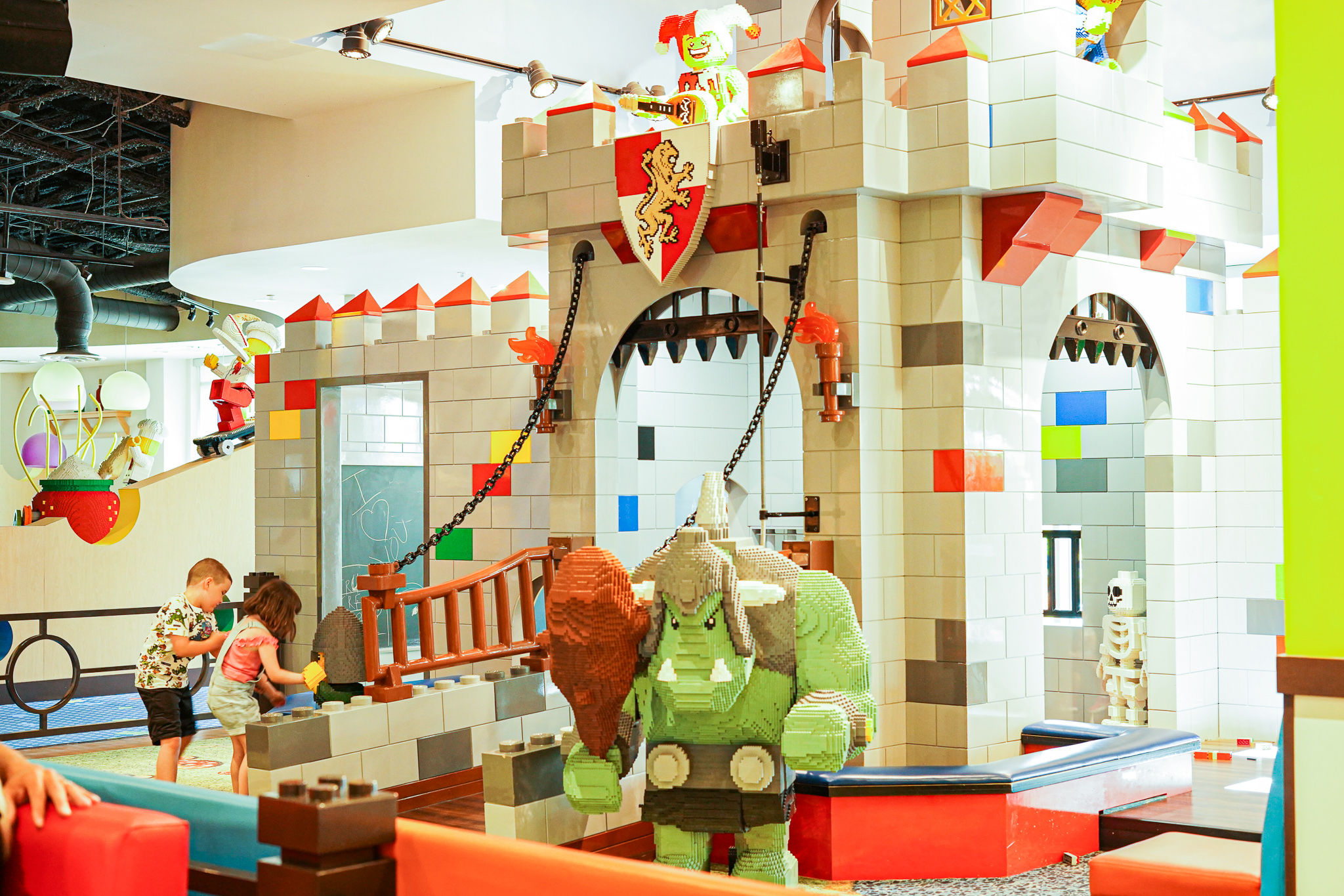 Kids playing in a large Lego castle.   A Guide to LEGOLAND Hotels in Florida