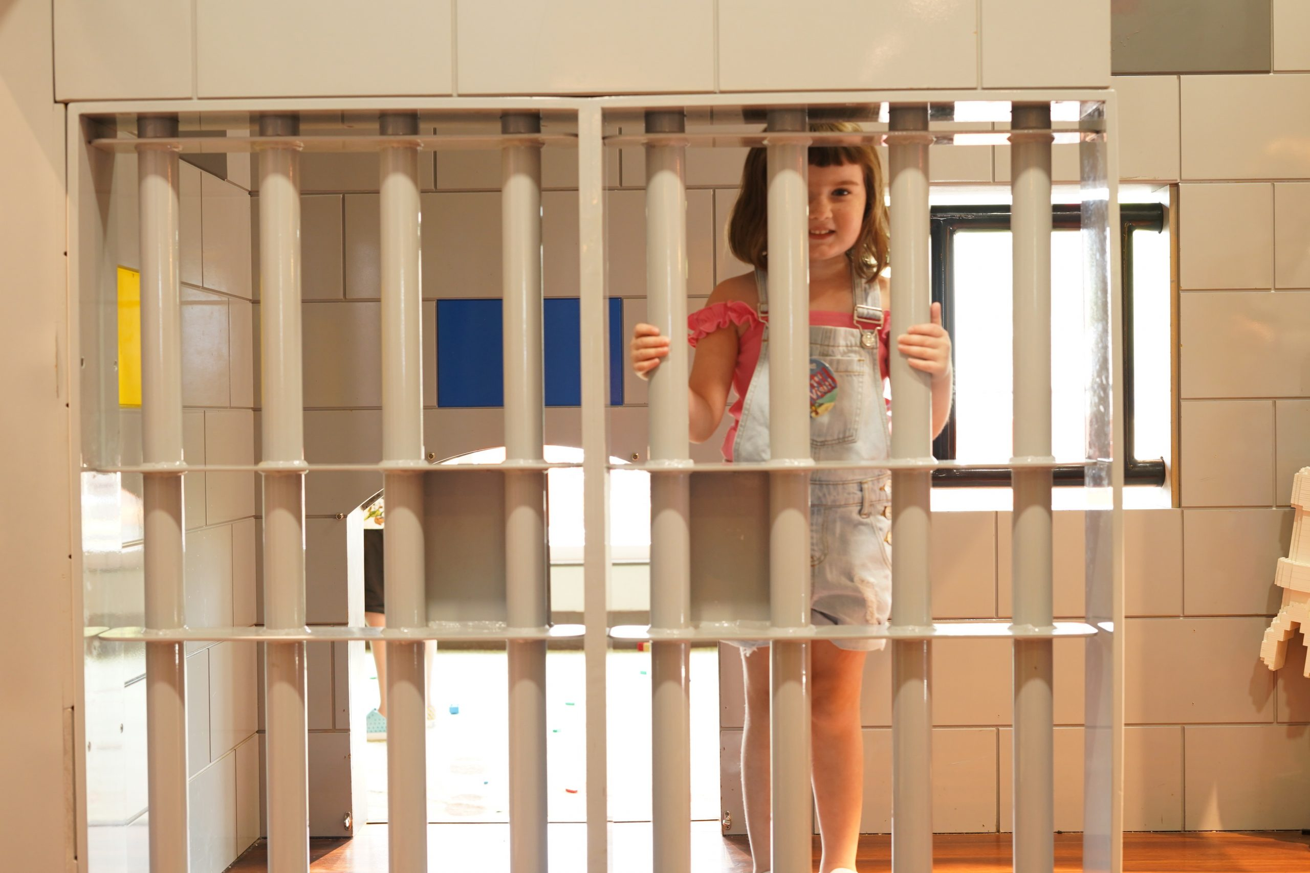 Little girl in the jail in the Lego caste.   A Guide to LEGOLAND Hotels in Florida