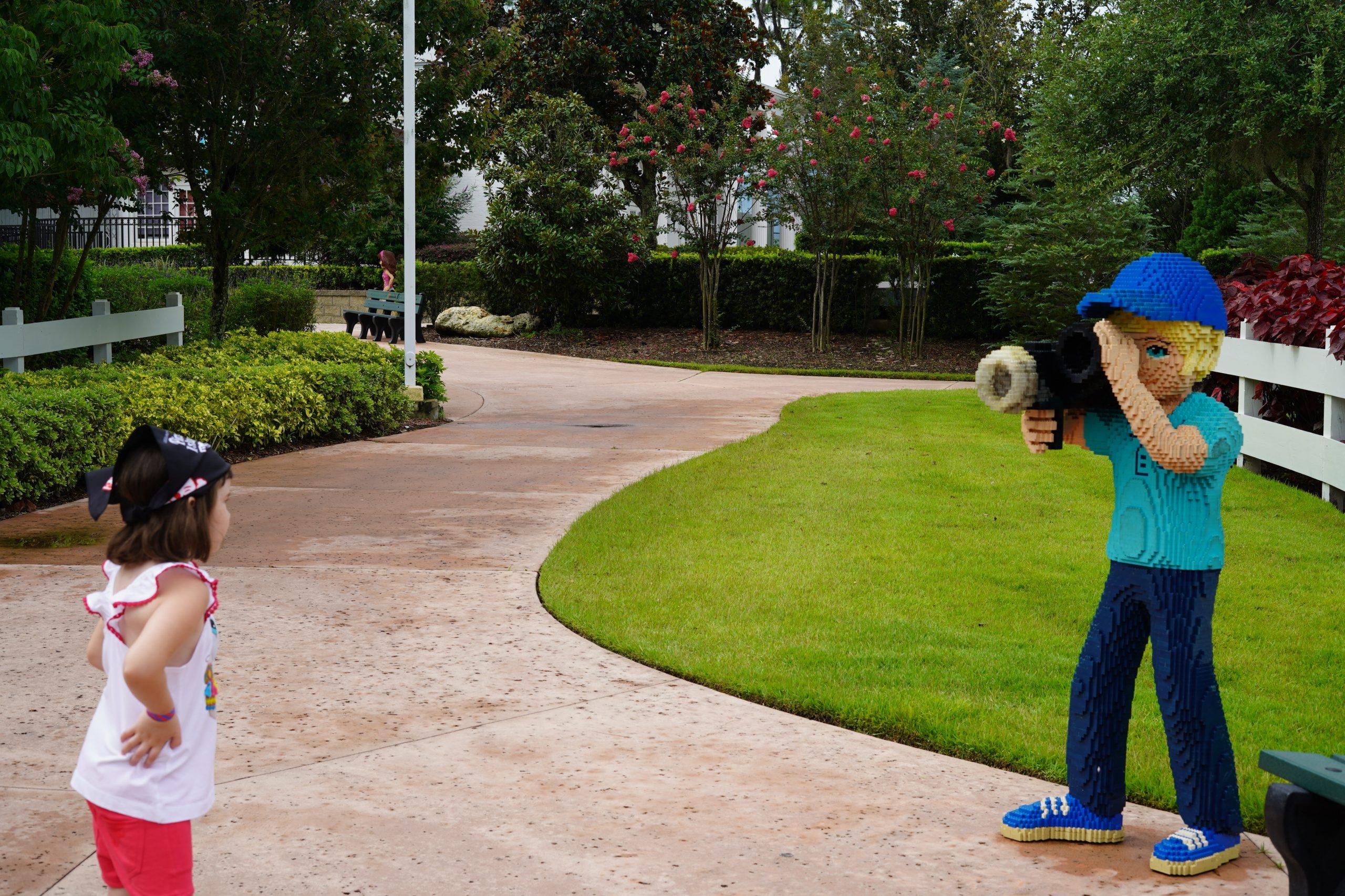Little girl posing for a lego camera man at LEGOLAND. | Guide to LEGOLAND Florida