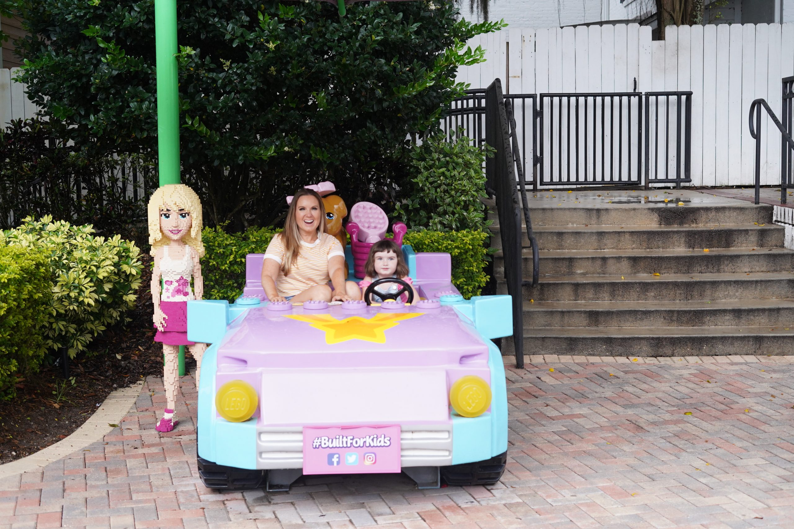 Mom and little girl in a play car at LEGOLAND. | Guide to LEGOLAND Florida