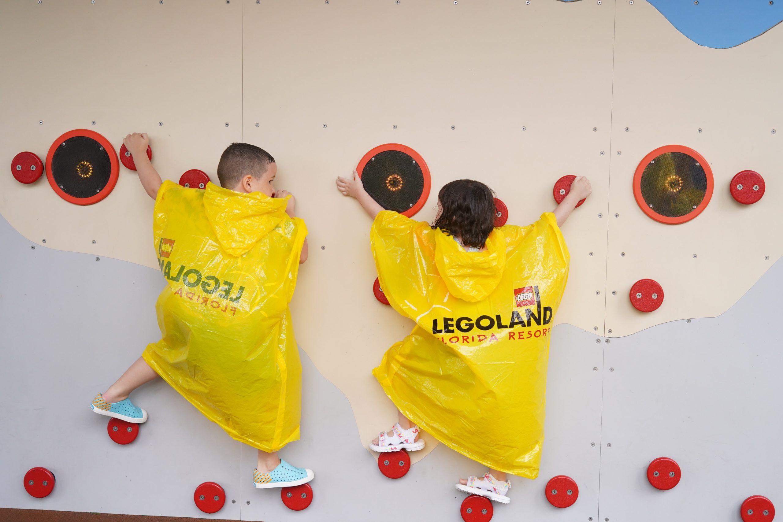 Two kids rock wall climbing at Ninjago world at LEGOLAND. | Guide to LEGOLAND Florida