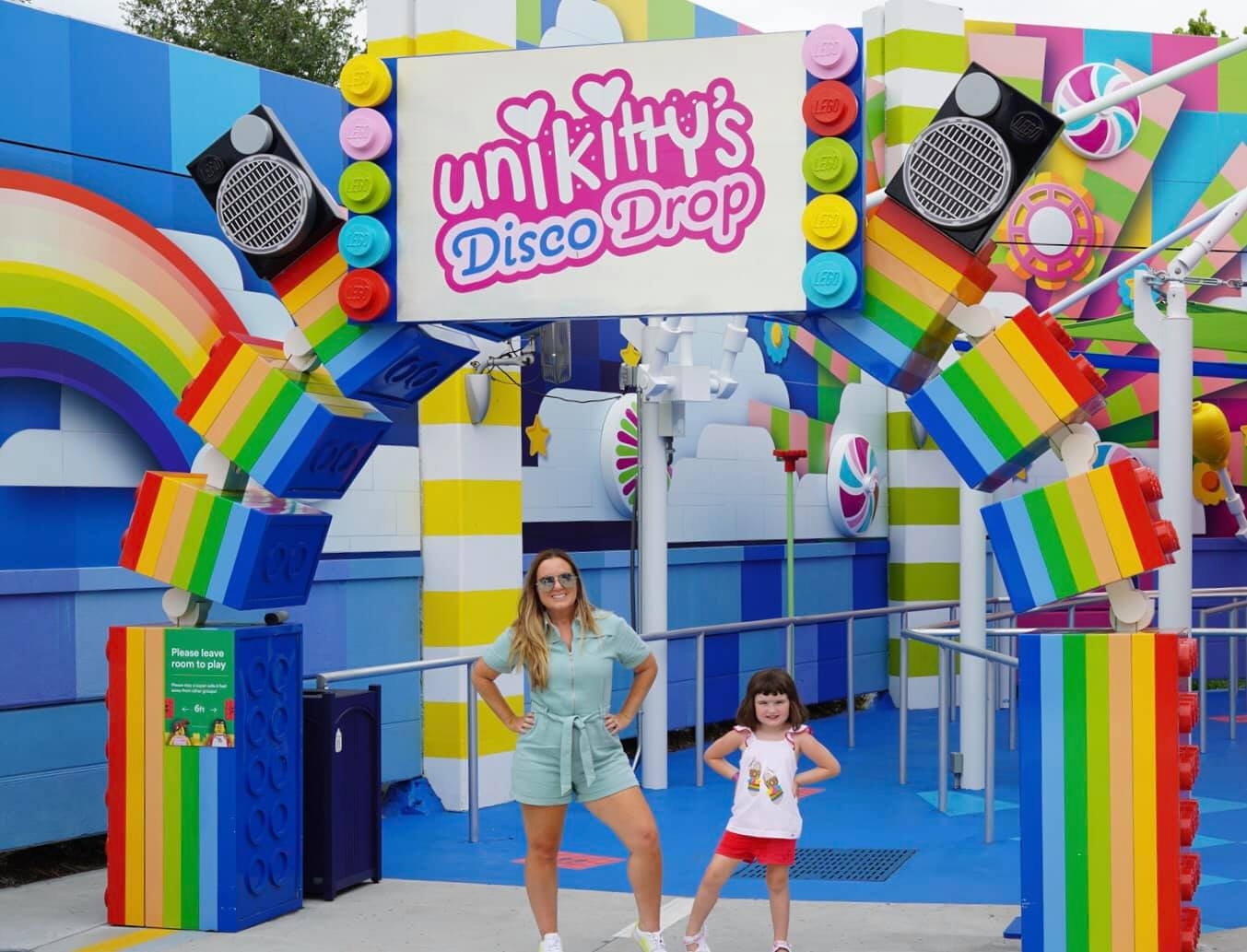 Mom and daughter posing in front of Unikitty's Disco Drop.| Guide to LEGOLAND Florida
