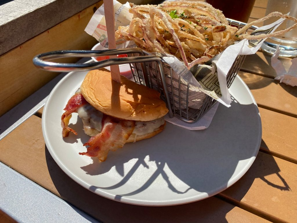 Plate of onion straws and half of a hamburger.   Where to Eat in Key West