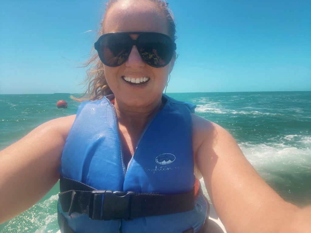 Woman taking a selfie on a wave runner in the ocean in Key West | Fury Water Adventures in Key West