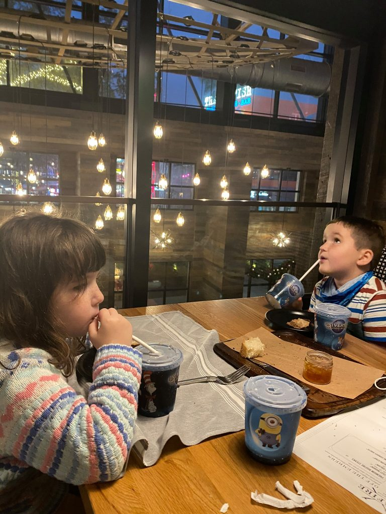 Two kids drinking at the restaurant table of Big Fire. | What to eat at Universal's Citywalk in Orlando