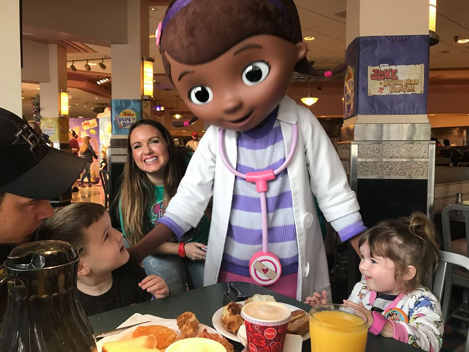 People eating breakfast with a character greeting them at the Hollywood studios restaurant at Disney World.   Disney World- What you need to know.