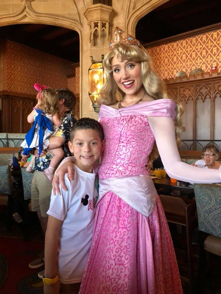 Little boy posing with Cinderella character at Hollywood studios restaurant at Disney World.   Disney World- What you need to know.