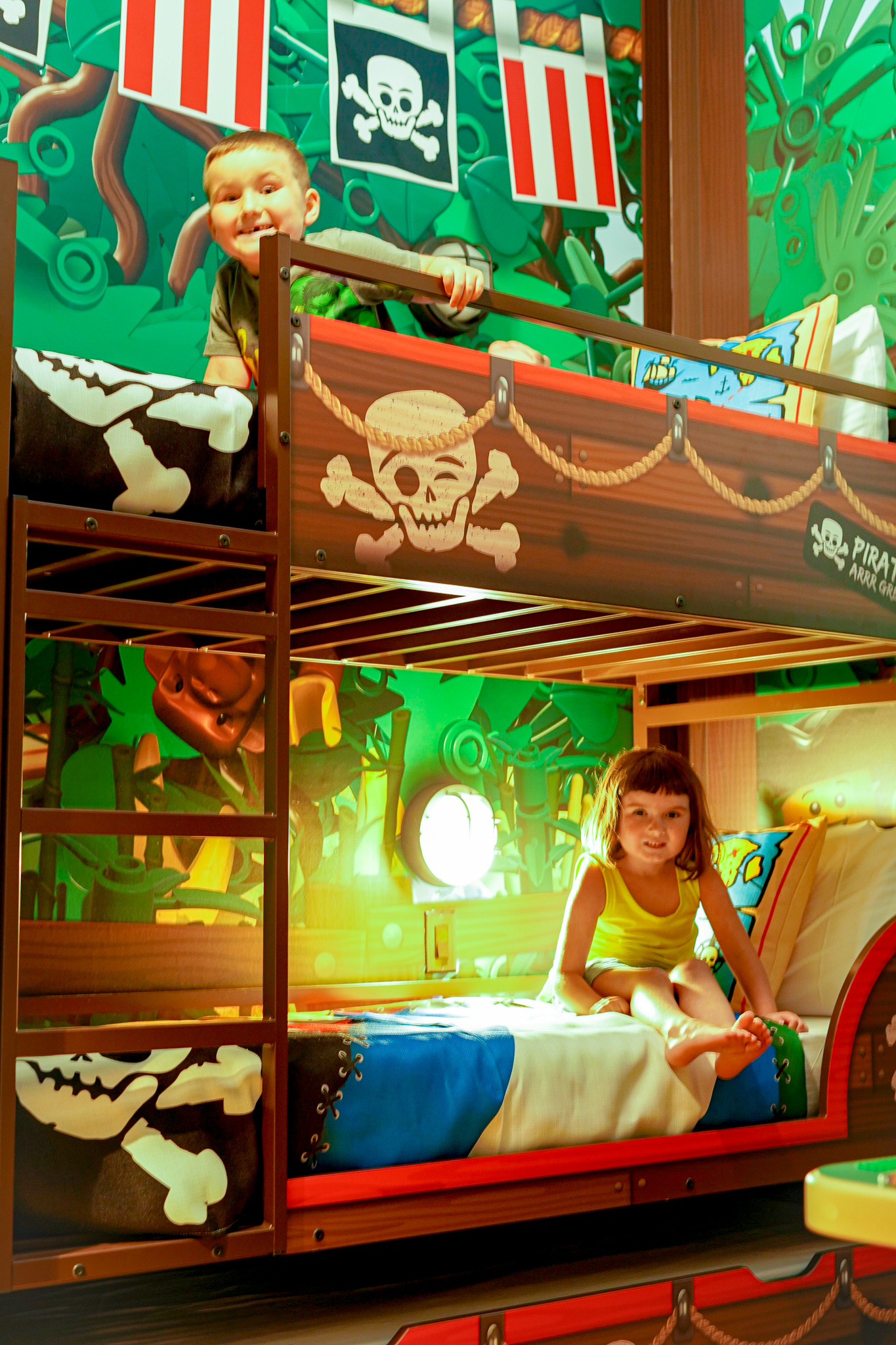 Two kids sitting in the bunk beds in the hotel room.  A Guide to LEGOLAND Hotels in Florida