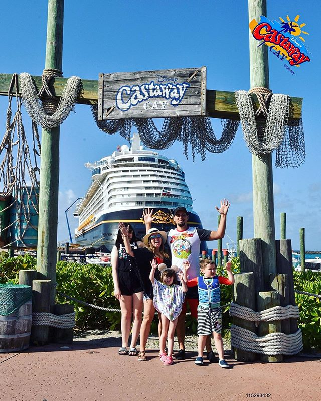 Family group shot in front of Castaway Cay sign. | Castaway Cay- Everything you need to know