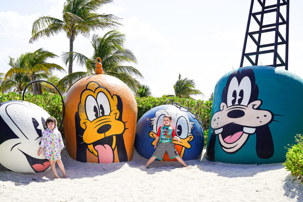 Kids posing in front of Disney characters. | Castaway Cay- Everything you need to know
