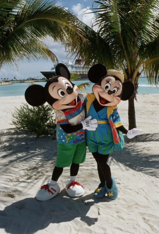 Mickey and Minnie Mouse characters posing for a picture on the beach. | Castaway Cay- Everything you need to know