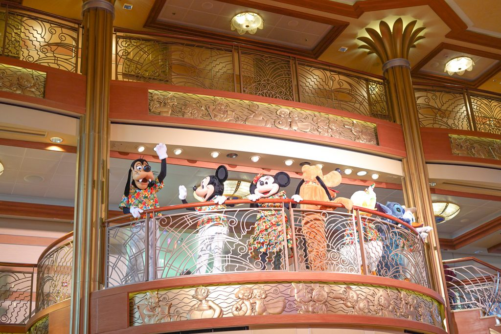 Disney characters on the balcony waving to guests on the cruise ship.  | Disney Dream Cruise
