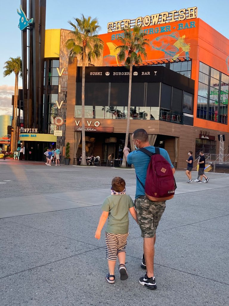 Man and child walking towards The Cowfish restaurant. | What to eat at Universal's Citywalk in Orlando