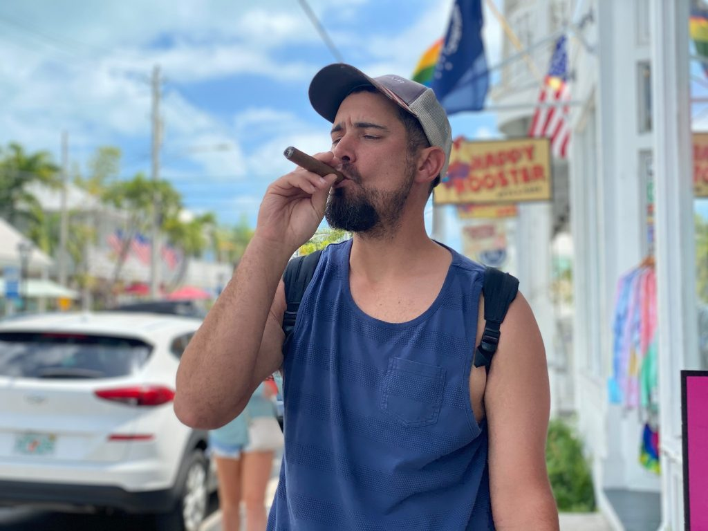 Man smoking a cigar on the street in Key West. | What you to need to know about Key West