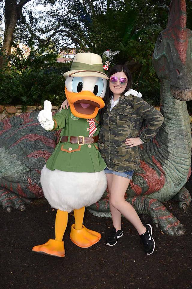 Girl posing with Donald Duck outside at Disney World.   Disney World- What you need to know.