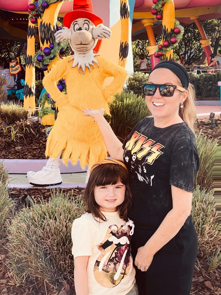 Woman with little girl posing in front of a statue of Dr. Seuss.   Universal's Islands of Adventure with Kids