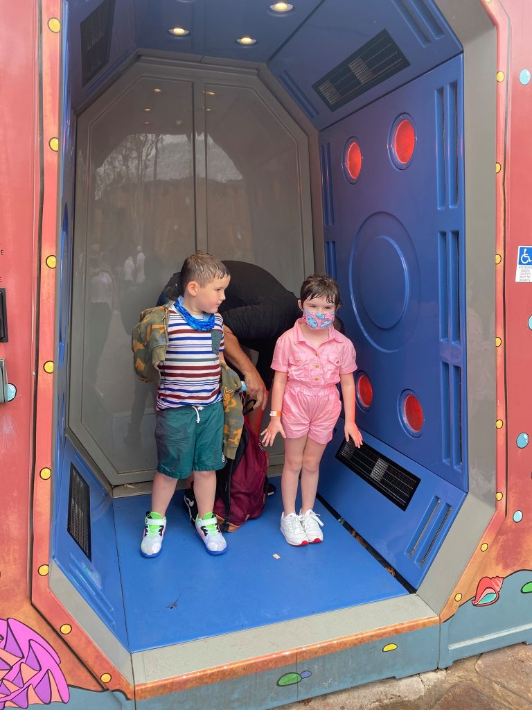 A little boy and a little girl drying off in the dryer at the water park.   Universal's Islands of Adventure with Kids