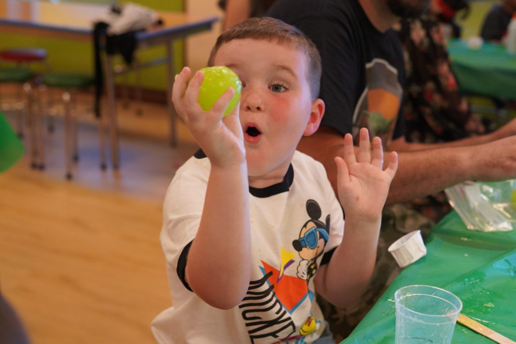 Little boy doing activities at kids club on the Disney cruise. | Disney Dream Cruise