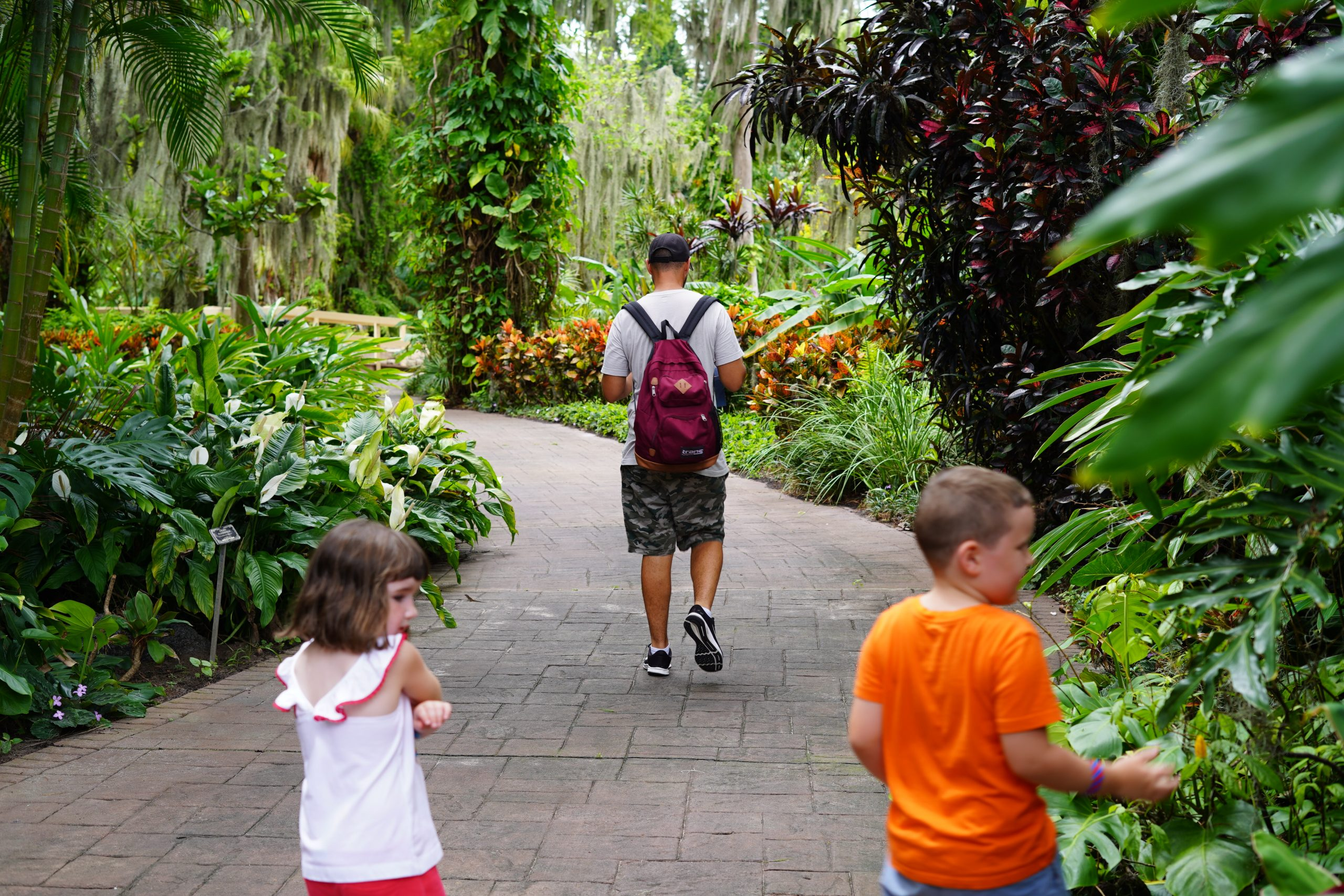 Man with two kids walking through the gardens at LEGOLAND. | Guide to LEGOLAND Florida