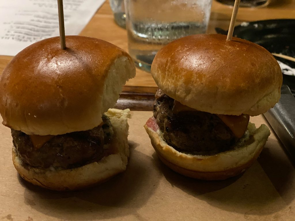 Two lamp burgers on a tray in the restaurant of Big Fire. | What to eat at Universal's Citywalk in Orlando