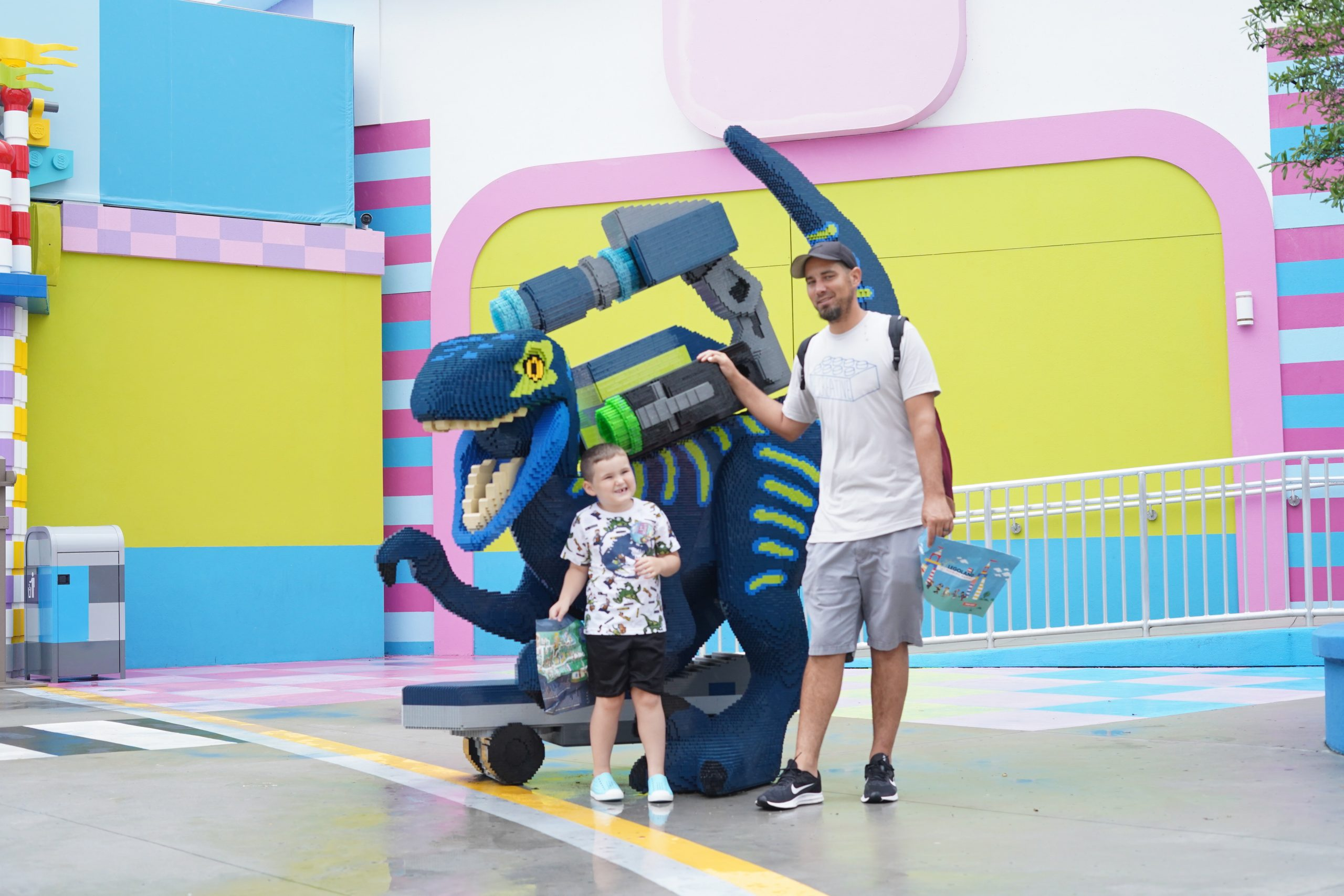 Man with little boy standing in front of lego dinosaur for the Lego Movie World in LEGOLAND.  | Guide to LEGOLAND Florida