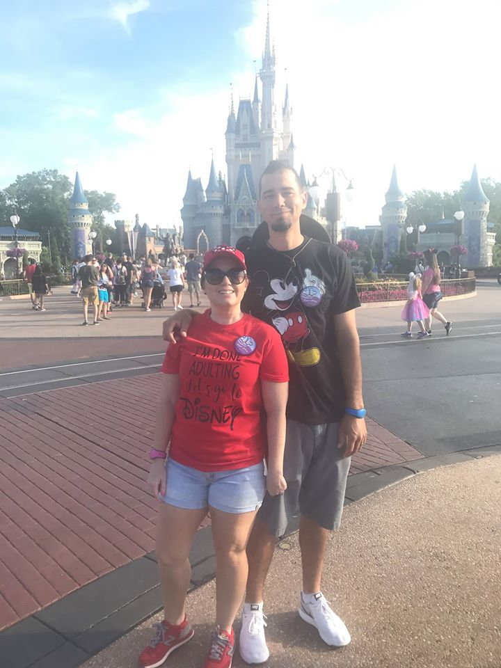 Couple posing in front of castle at Disney World..   Disney World- What you need to know.