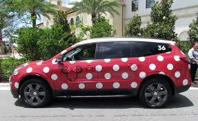 Red polka dot mini van service decorated like Minnie Mouse at Disney World.   Disney World- What you need to know.
