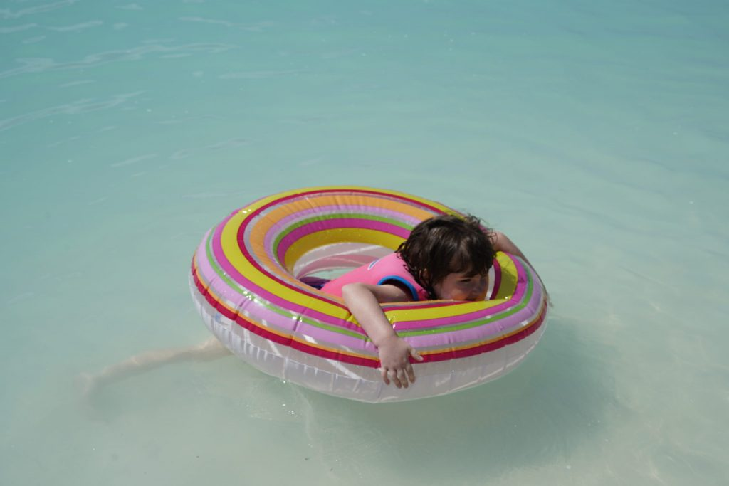 Little girl on a pool float in the water. | Castaway Cay- Everything you need to know