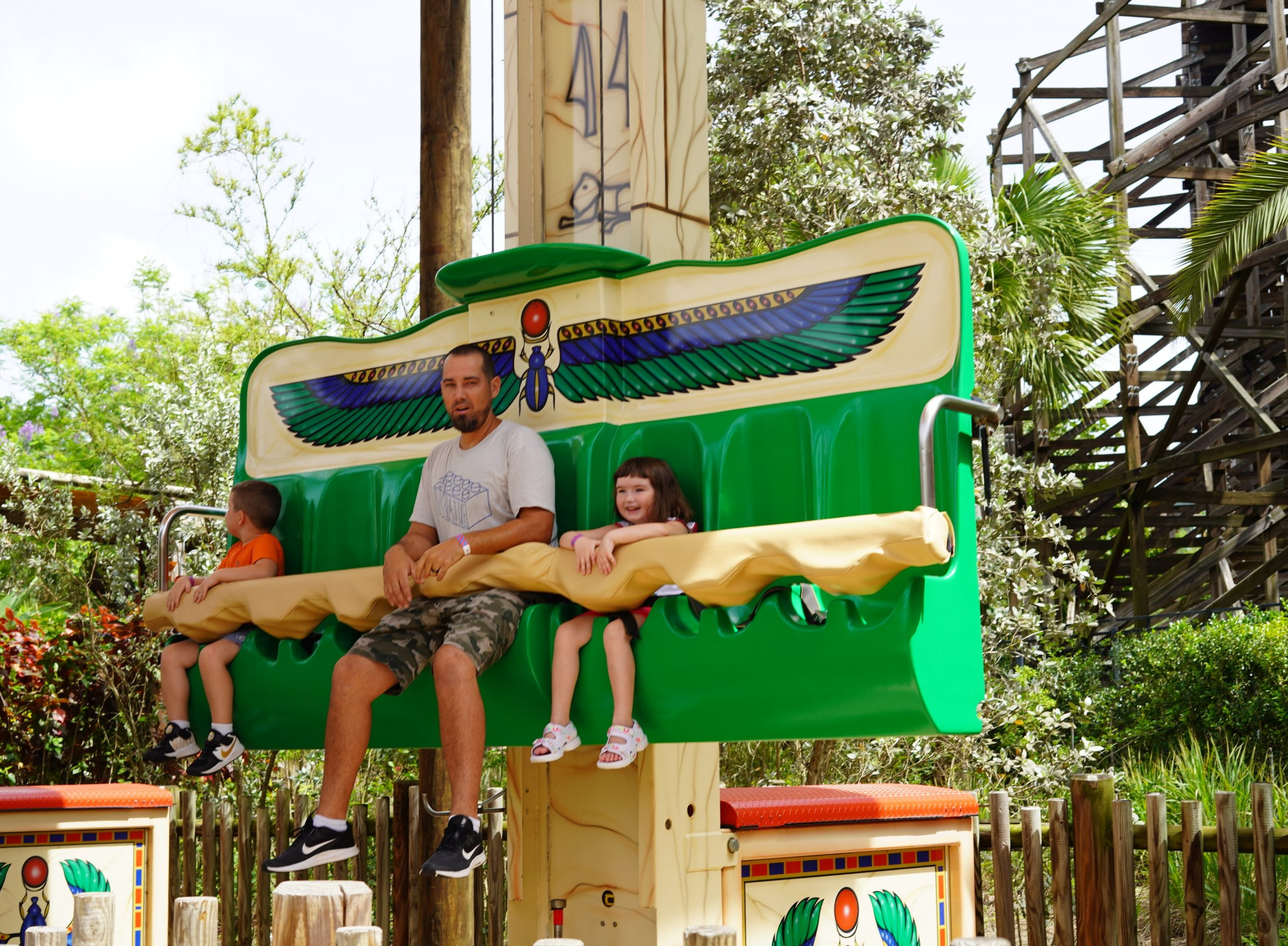 Dad with two kids on a ride at LEGOLAND. | Guide to LEGOLAND Florida
