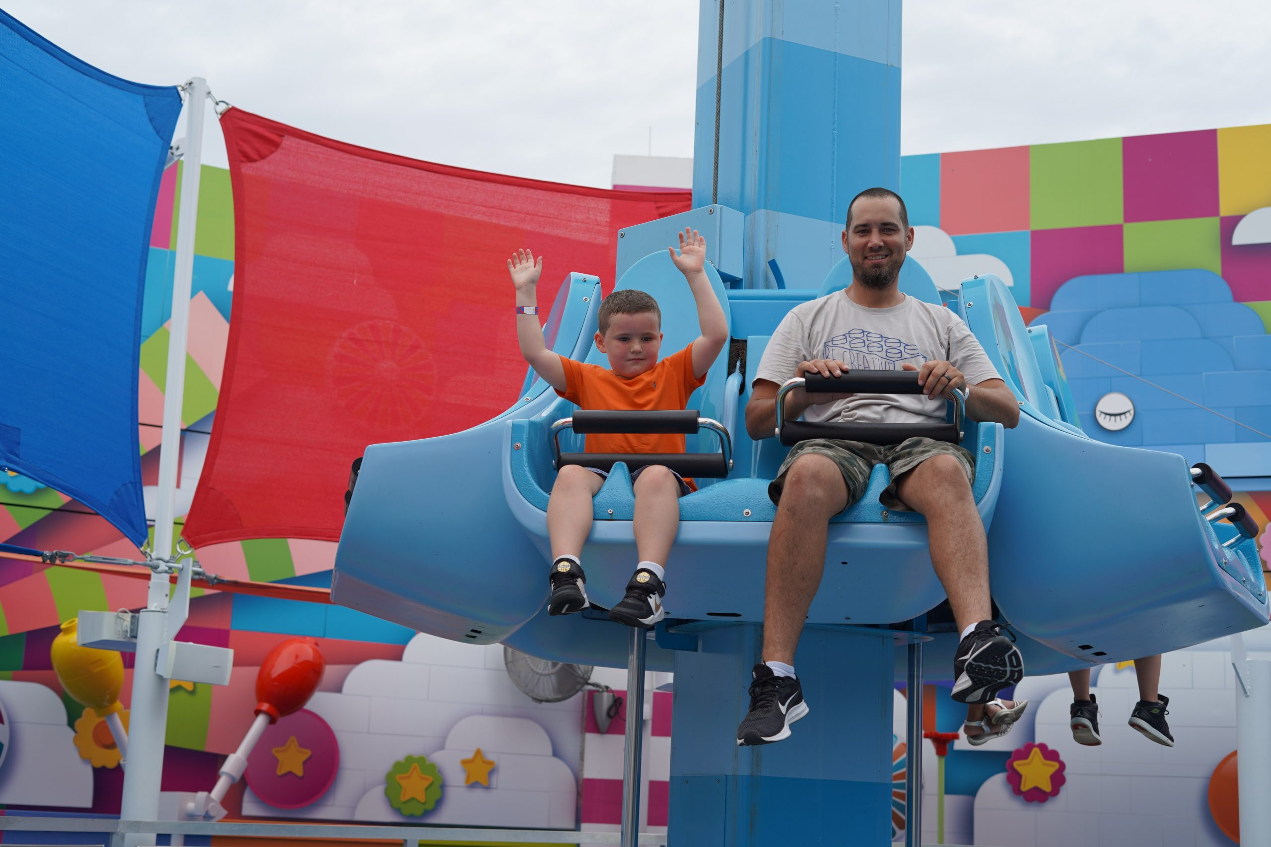 Man with little boy on a ride in LEGOLAND.  | Guide to LEGOLAND Florida