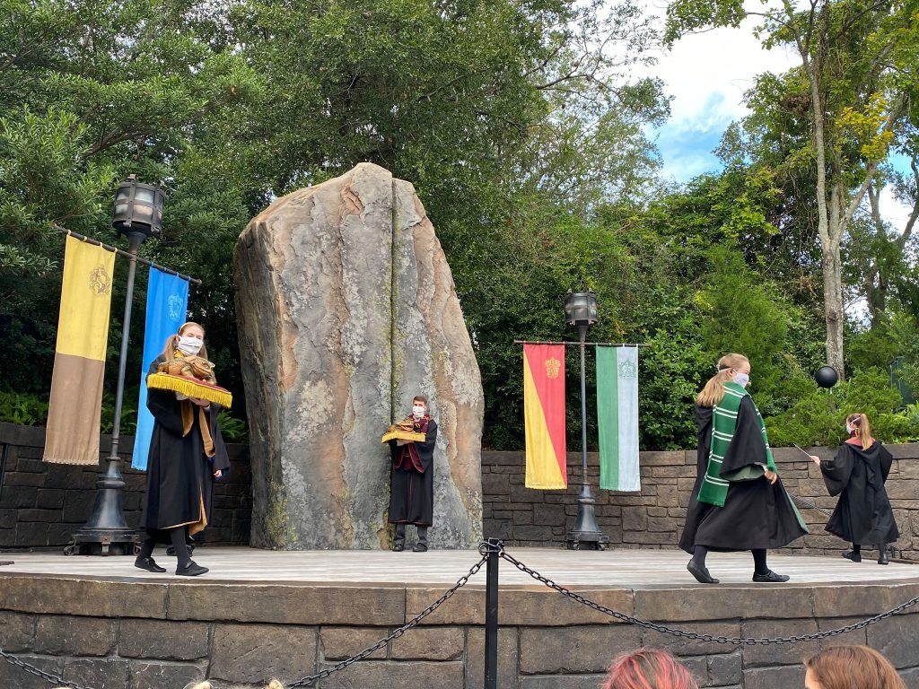 Harry Potter show with people on stage singing.   Universal's Islands of Adventure with Kids