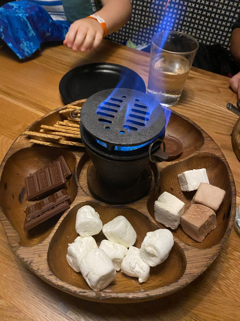 S'more tray with chocolate, marshmallows, graham crackers and a mini fire in the restaurant of Big Fire. | What to eat at Universal's Citywalk in Orlando