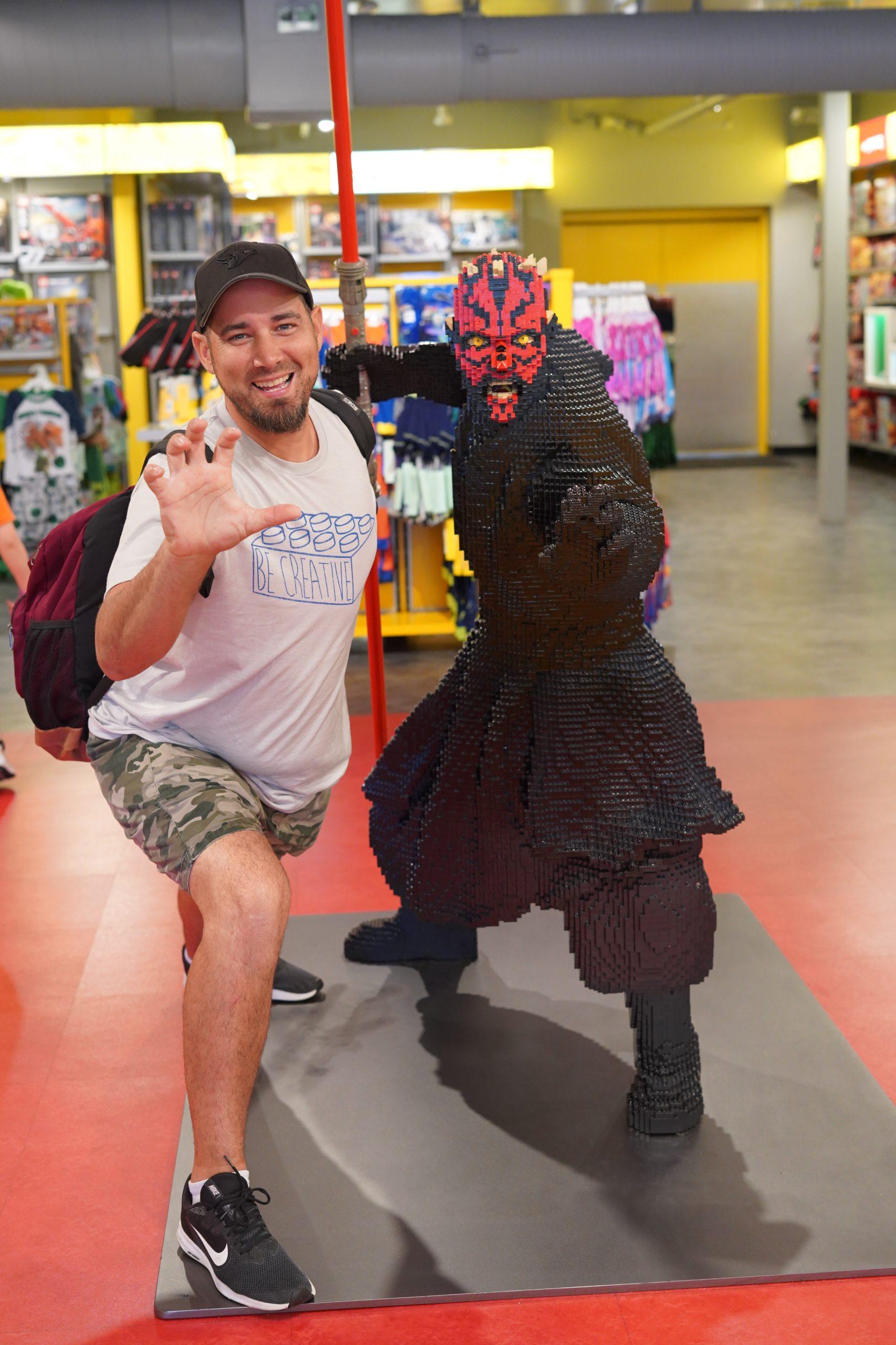 Man posing with lego Star Wars figurine at LEGOLAND. | Guide to LEGOLAND Florida