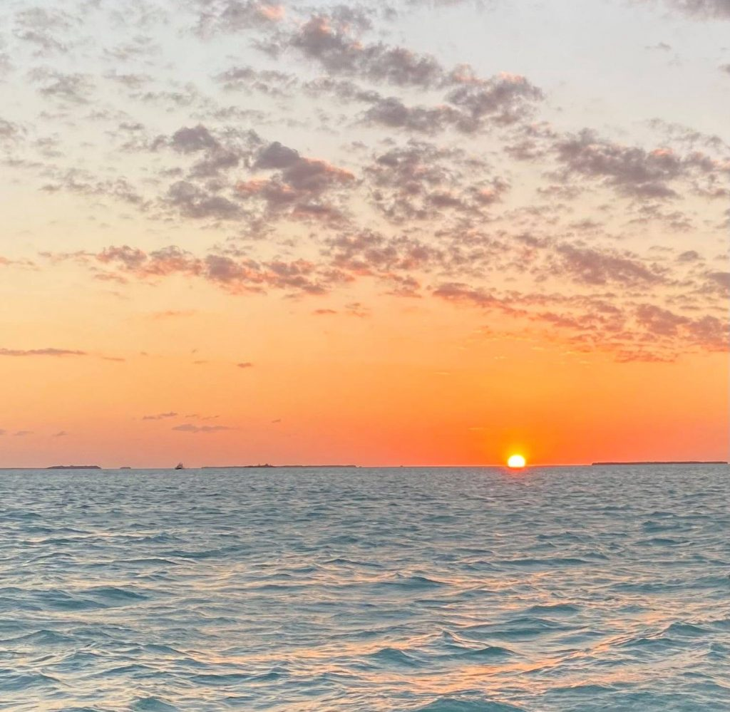 Sunset over the ocean in Key West.   What to expect on a Key West Sunset Cruise, on a Schooner America Sailboat