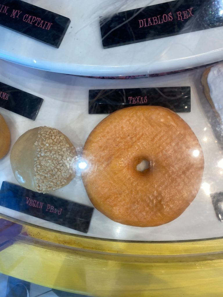 Texas-flavored donut in the display case. | What to eat at Universal's Citywalk in Orlando