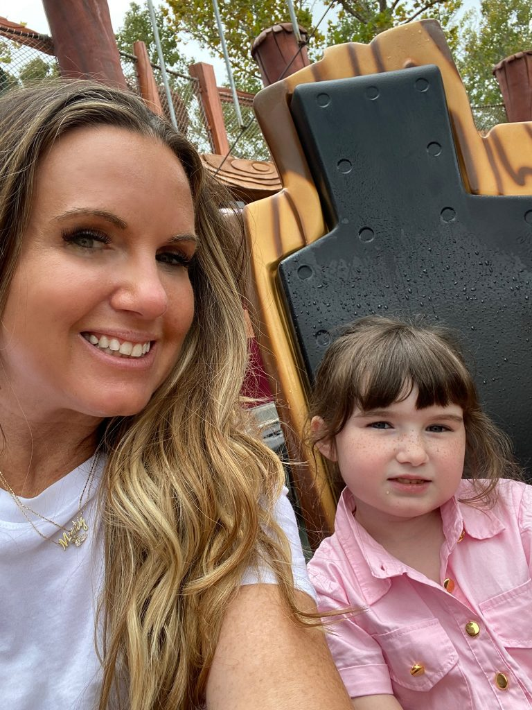 Woman with a little girl on a water ride, taking a selfie together.   Universal's Islands of Adventure with Kids