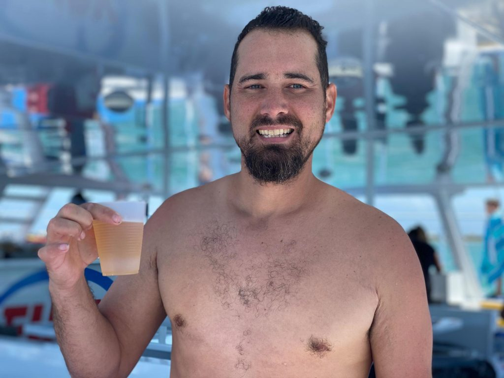 Man posing with a cup of wine on a boat in Key West | Fury Water Adventures in Key West